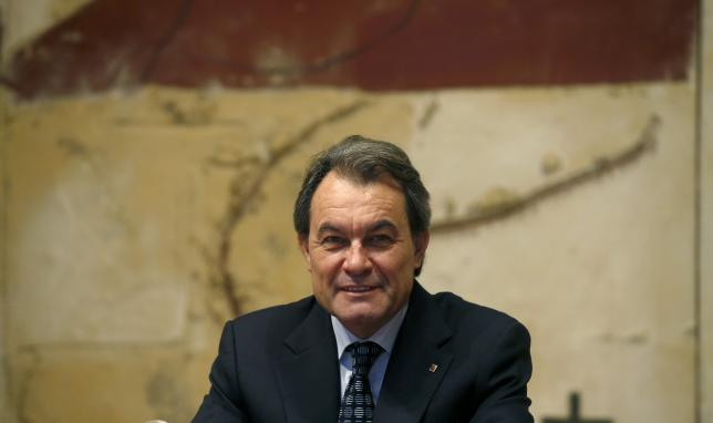 Catalan acting President Artur Mas attends a government meeting at Palau de la Generalitat in Barcelona