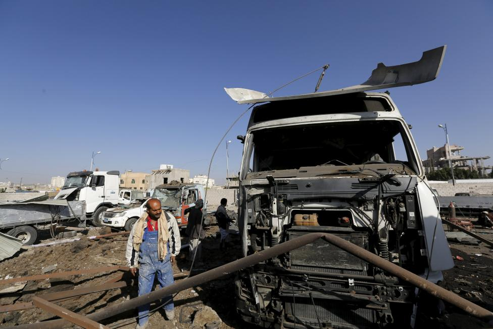 Worker inspects damage at a car maintenance workshop after it was hit by a Saudi-led air strike in Yemen's capital Sanaa