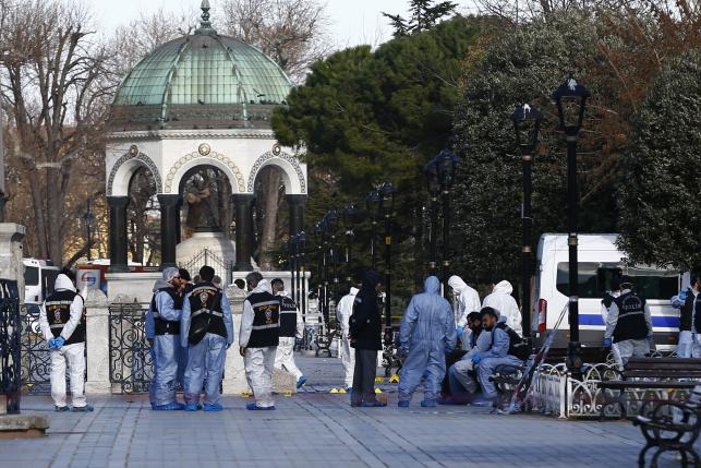Police forensic officers attend scene after an explosion in front of the German Fountain in Sultanahmet Square in Istanbul