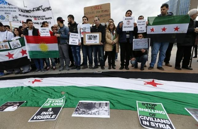 People demonstrate against the Syrian regime ahead of the start of the Syrian Peace talks outside the U.N. European headquarters in Geneva
