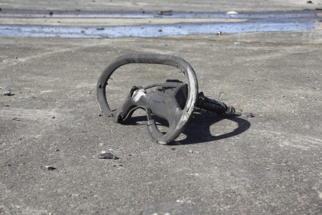 A damaged vehicle part is pictured at the scene of an explosion at the Police Training Centre in  the town of Zliten