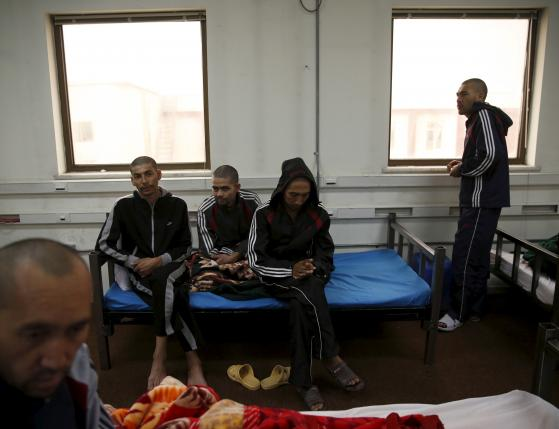 Drug addicts sits on their beds at a newly-opened treatment centre at Camp Phoenix, in Kabul, Afghanistan