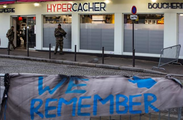 A French soldier patrols after French President attended a ceremony to pay tribute to the victims of last year's January attacks outside the Hypercacher kosher supermarket in Paris