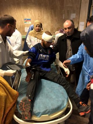 An injured Man receives treatment inside a hospital in Misurata
