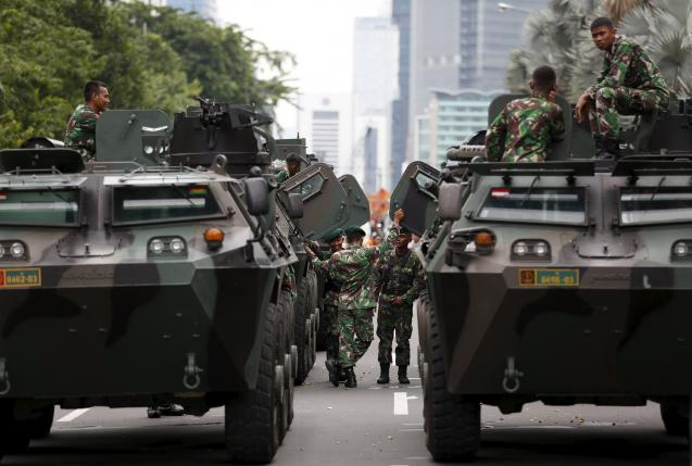 Military armoured personnel carriers are seen near the site of an attack in central Jakarta