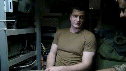 An undated picture released by Iran's Revolutionary Guards website shows an American sailor sitting in the U.S. boat detained by Iran in an unknown place, Iran