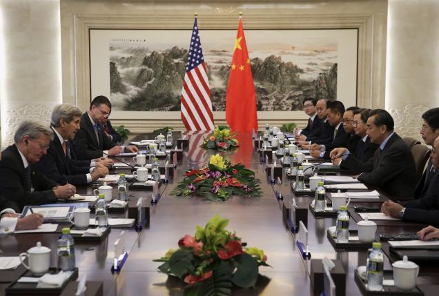 U.S. Secretary of State John Kerry speaks with Chinese Foreign Minister Wang Yi during their bilateral meeting at the Ministry of Foreign Affairs in Beijing