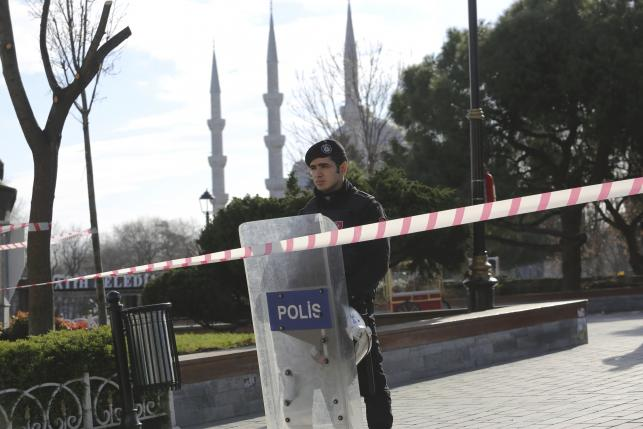Police officer secures area after an explosion near the Ottoman-era Sultanahmet mosque in Istanbul