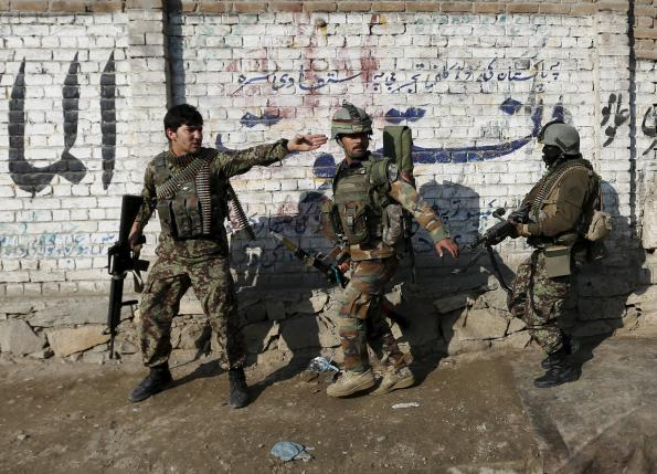 Afghan National Army (ANA) soldiers arrive after a blast near the Pakistani consulate in Jalalabad