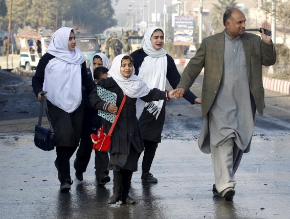 School children react as they were led away after a blast near the Pakistani consulate in Jalalabad