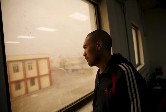 A drug addict looks out of a window at a newly-opened treatment centre at Camp Phoenix, in Kabul, Afghanistan