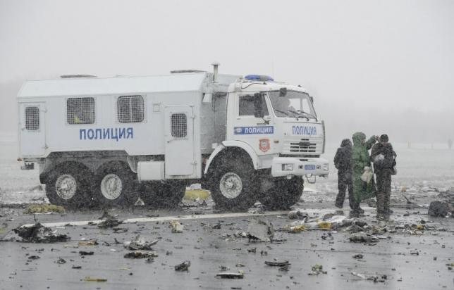 A police truck is seen at the crash site of Flight number FZ981, a Boeing 737-800 operated by Dubai-based budget carrier Flydubai, at the airport of Rostov-On-Don, Russia
