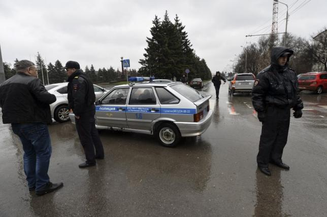 Interior Ministry members stand guard outside airport of Rostov-On-Don