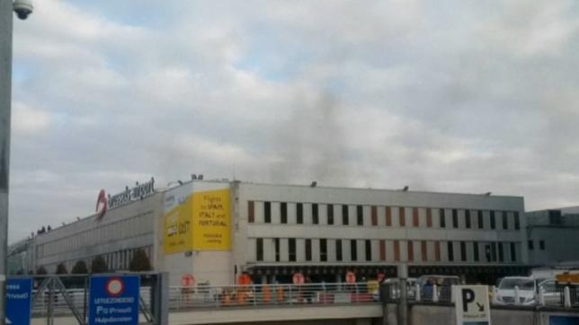 Still image shows black smoke rising from the Brussels airport following explosions