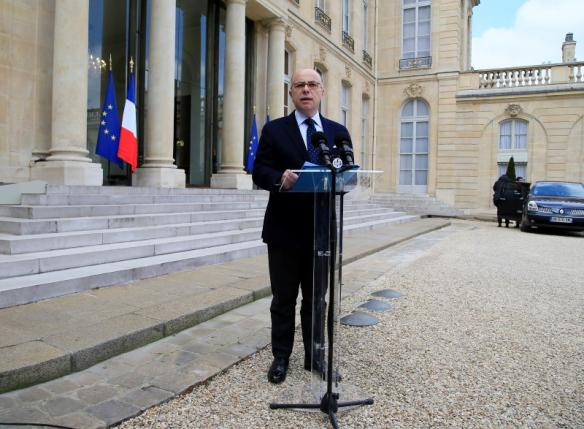 French Interior Minister Cazeneuve talks to journalists after a meeting about blasts in Brussels at the Elysee Palace in Paris