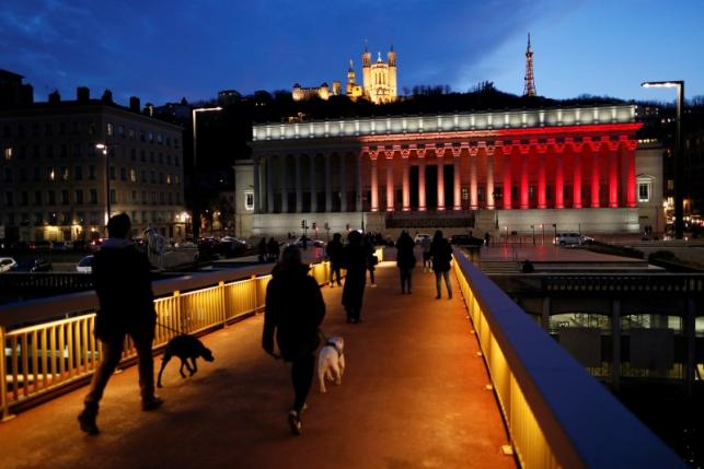 The black, yellow, and red colors of the Belgian flag are projected on the courthouse in Lyon in tribute to the victims of today's Brussels bomb attacks