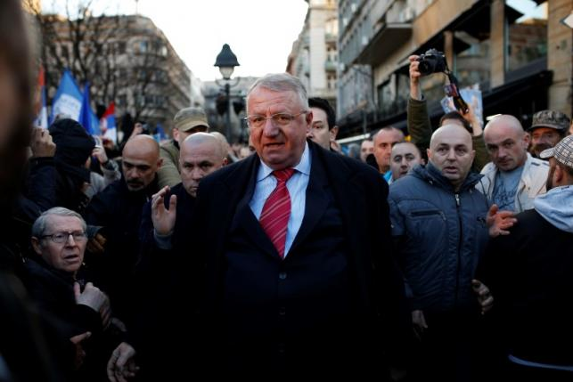 Serbian ultra-nationalist leader Seselj surrounded by his supporters arrives for an anti-government rally in Belgrade