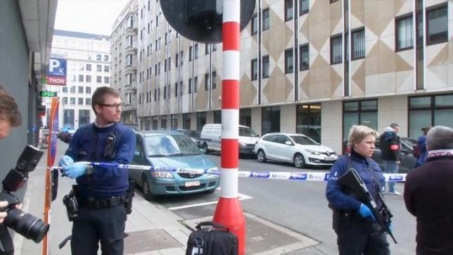 Still image taken from video of emergency personnel at the scene of a blast outside a metro station in Brussels