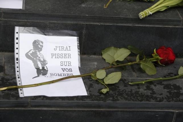 Flowers tributes are placed on steps of Belgian embassy in Berlin