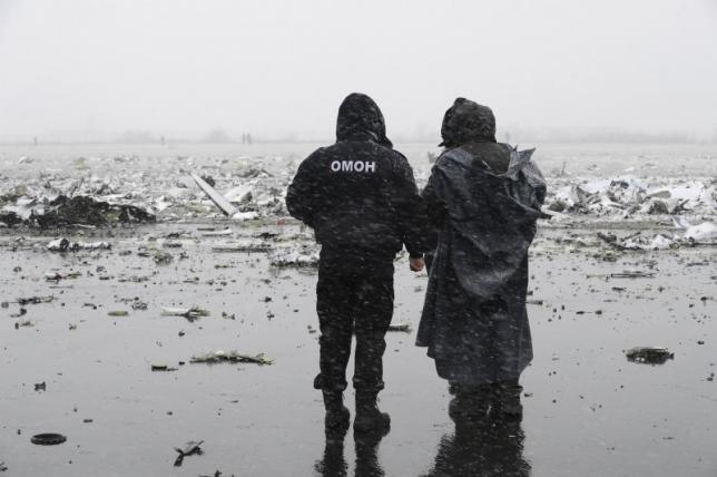 An officer of the special police force stands guard at the crash site of Flight FZ981, a Boeing 737-800 operated by Dubai-based budget carrier Flydubai, at the airport of Rostov-On-Don, Russia