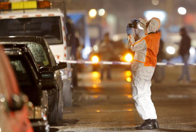 A Belgian forensic police takes pictures during police operations in Schaerbeek