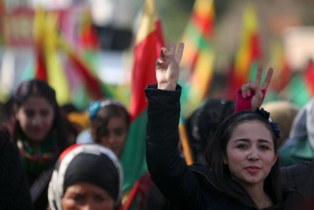 File photo of Kurdish people taking part in a protest in the city of al-Derbasiyah