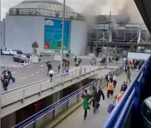 Still image shows people fleeing from Brussels airport shot by bystander in immediate aftermath of blasts at the airport near Brussels