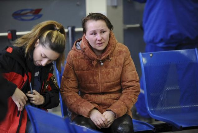 Relative of a victim of crashed Flydubai Boeing 737-800 reacts at airport of Rostov-On-Don