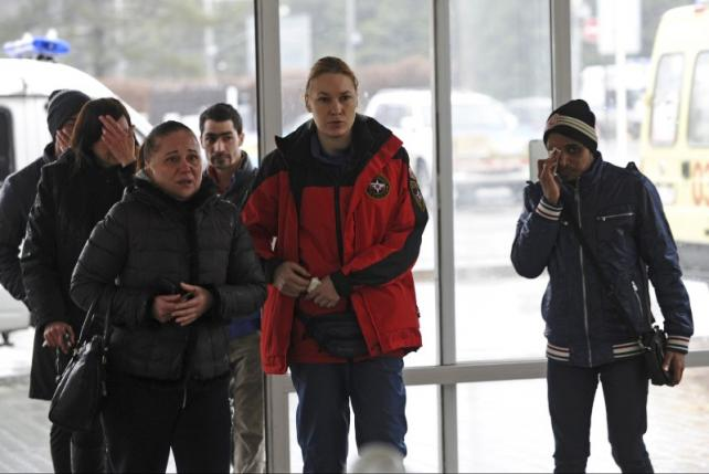 Relative of victims of crashed Flydubai Boeing 737-800 are seen at airport of Rostov-On-Don