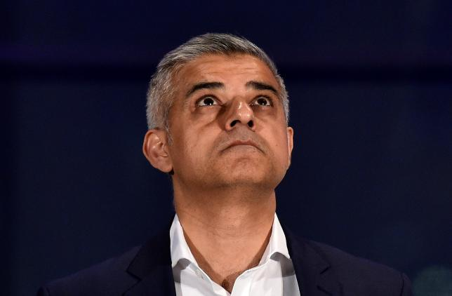 Labour Party candidate for Mayor of London Khan reacts following his victory in London