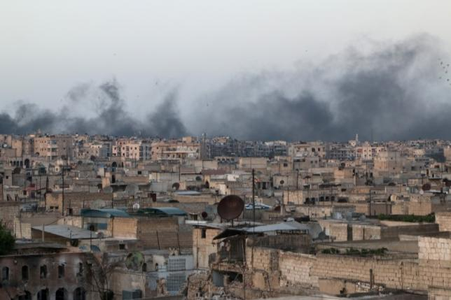 Smoke rises after airstrikes on the rebel-held al-Sakhour neighborhood of Aleppo