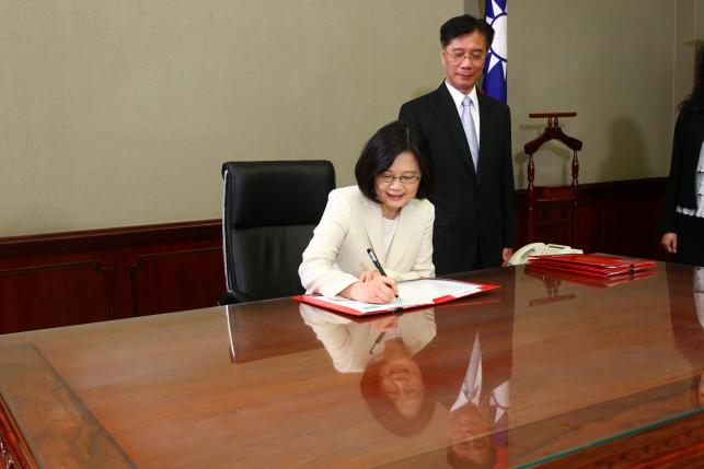 Taiwan's President Tsai Ing-wen signs after swearing in at the Presidential Office in Taipei