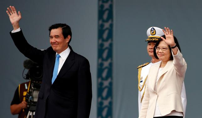 Taiwan's new president Tsai Ing-wen and former president Ma Ying-jeou wave during an inauguration ceremony in Taipei