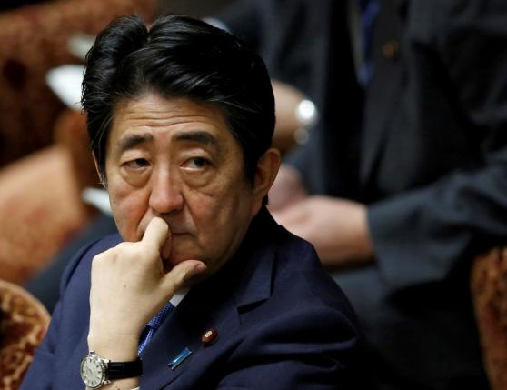 Japan's PM Abe attends a lower house budget committee session at the parliament in Tokyo