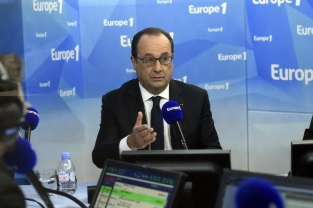 France's President Francois Hollande replies to a question during a morning radio show on France's Europe 1 station in Paris