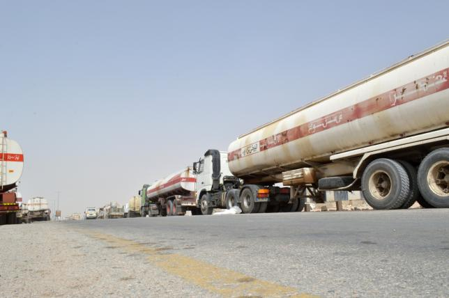 Fuel tanker trucks carrying smuggled petrol are seen on a road linking Bir Ali with Ataq city, the provincial capital of Shabwa province