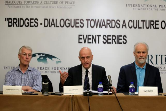 Uwe Morawetz, chairman of International Peace Foundation, speaks next to Nobel laureate Richard Roberts and Prince Alfred of Liechtenstein at a news conference in Beijing