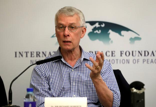 Nobel laureate Richard Roberts speaks at a news conference in Beijing