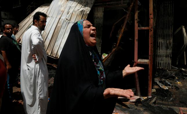 A woman reacts at the scene of a car bomb attack in Baghdad's mainly Shi'ite district of Sadr City