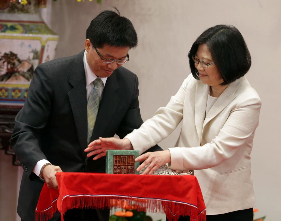 Taiwan's President Tsai Ing-wen receives an official seal after swearing in at the Presidential Office in Taipei