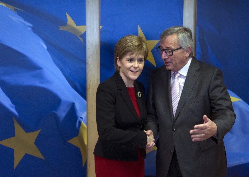 Scotland's First Minister Sturgeon is welcomed by European Commission President Juncker ahead of a meeting at the EC headquarters in Brussels