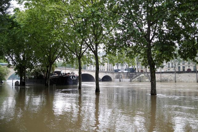 General view of the flooded river-side of the River Seine in central Paris with the 'Ile Saint-Louis' in the background