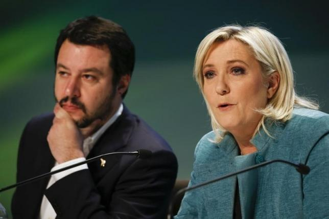 "France's far-right National Front political party leader Le Pen talks next to Northern League leader Salvini, during a news conference at the end of the ""Europe of Nations an freedom"" meeting in Milan"