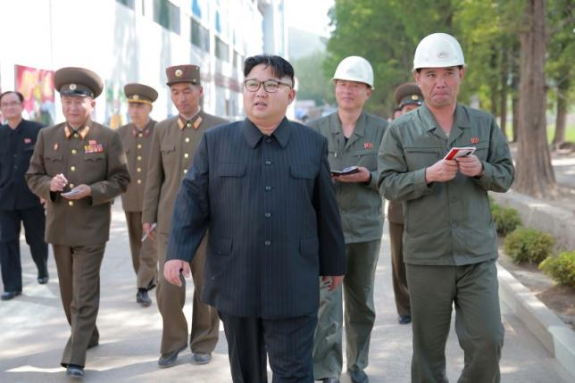 North Korean leader Kim Jong Un visits the construction site of Ryongaksan soap factory in this undated photo released by North Korea's Korean Central News Agency