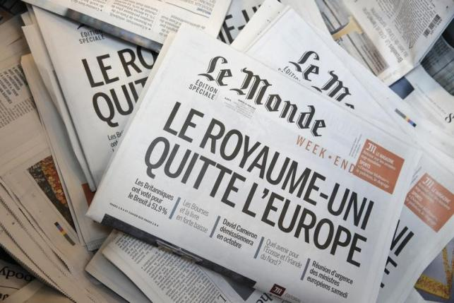 The front page of daily newspaper Le Monde is seen at their printing works following Britain's referendum results to leave the European Union