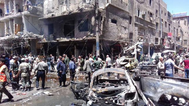 Men and Syrian Army members inspect a damaged site after a suicide and car bomb attack in south Damascus Shi'ite suburb of Sayeda Zeinab