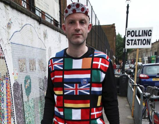 A man wearing a European themed cycling jersey arrives to vote at a polling station for the Referendum on the European Union in north London