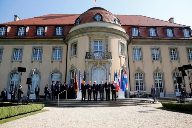 Ministers pose for a group picture before a foreign minister meeting of the EU founding members in Berlin