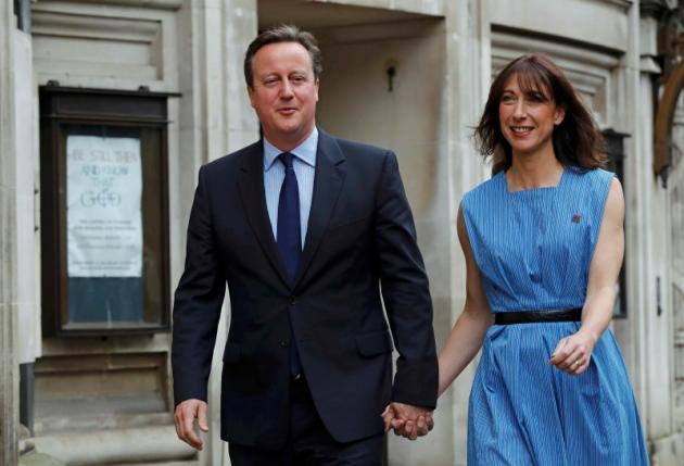 Britain's Prime Minister David Cameron and his wife Samantha arrive to vote in the EU referendum, at a polling station in central London