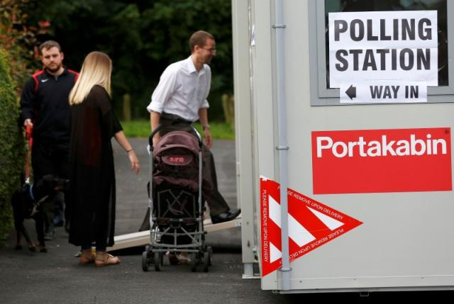 People arrive to vote at a polling station for the Referendum on the European Union in Heald Green, Stockpor